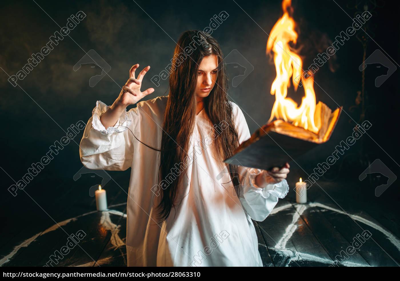 woman, sitting, in, burning, pentagram, circle, - 28063310