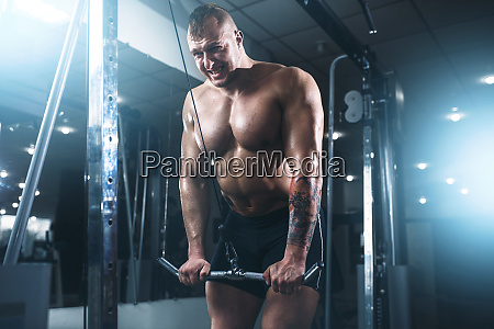 strong athlete with muscular body lifting