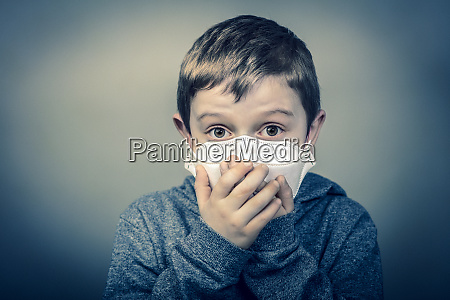 child with face mask wraps his