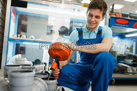 sanitary technician with pipe wrench at