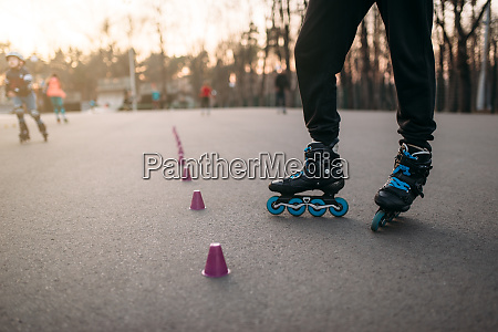 roller skater legs in skates on