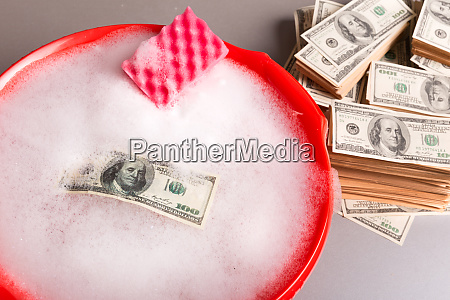 dollars banknotes are washing in foam