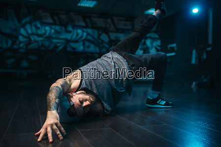 breakdance motions performer in dance studio