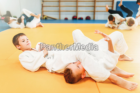 boys in uniform practice martial art