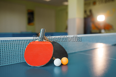 two ping pong paddles on the
