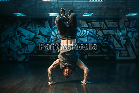 young breakdance performer upside down motion