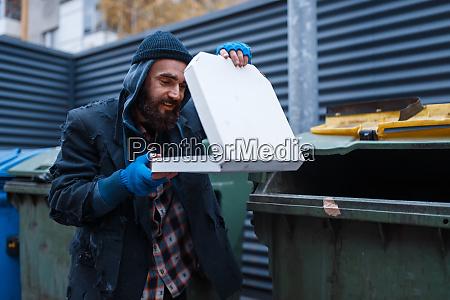 bearded dirty beggar found pizza in