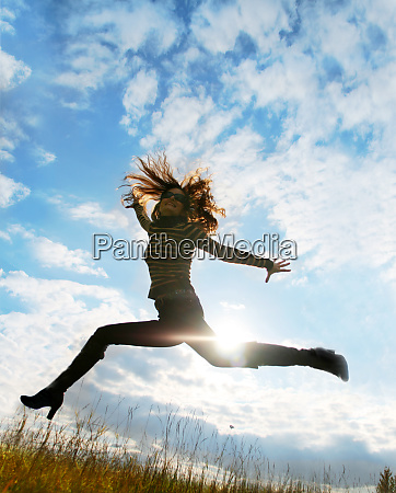 playful woman jumping