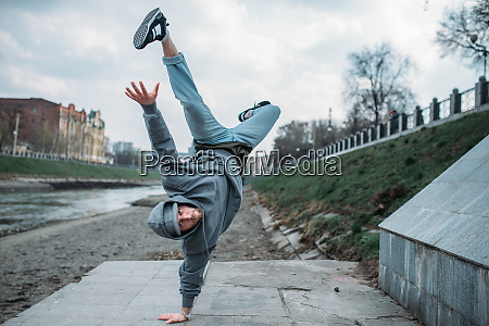 breakdance performer upside down motion on