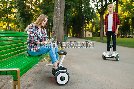 couple leisures with gyro board in