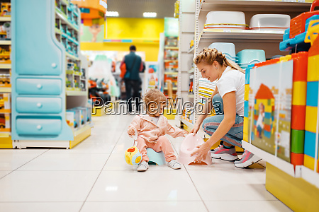 mother with girl choosing baby potty