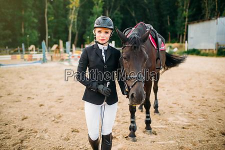 equestrian sport female jockey and horse