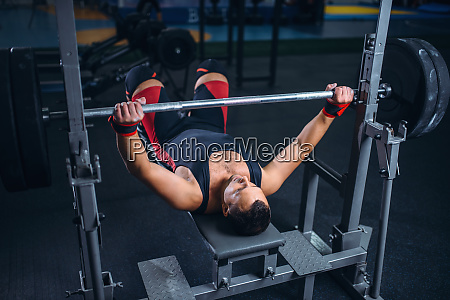 weight lifter on exercise machine with