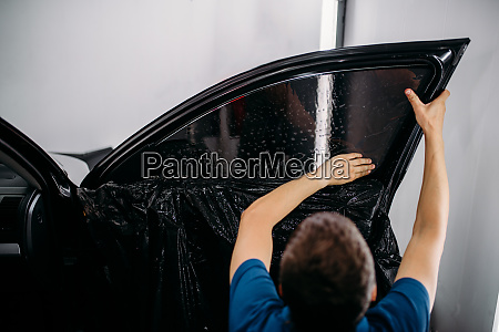 specialist with drier tinting film installation