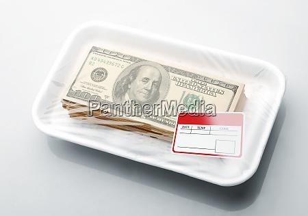stack of money in vacuum packaging
