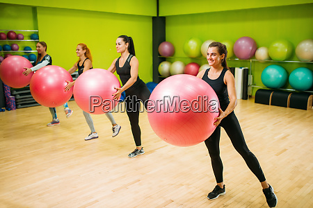 women group with big balls doing
