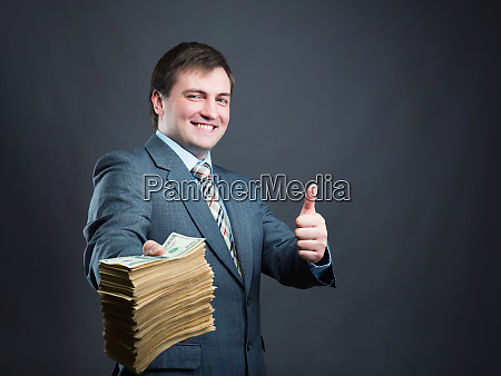 man with pack of money