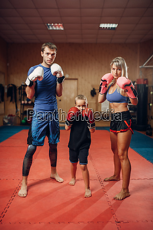 young family in gloves on kickboxing