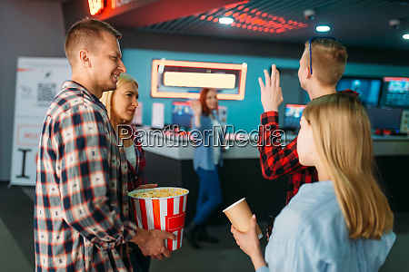 friends buying tickets in cinema box