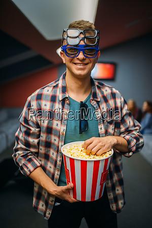 male spectator in 3d glasses cinema