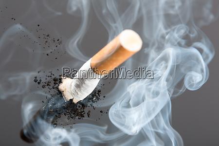 cigarette butt in smoke
