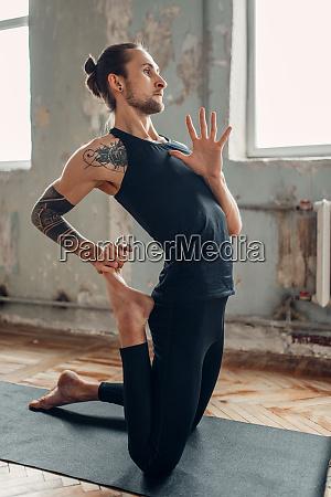 male yoga in class flexibility training
