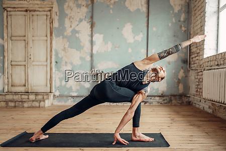 male yoga doing flexibility exercise