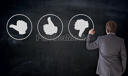 businessman writes like buttons on blackboard