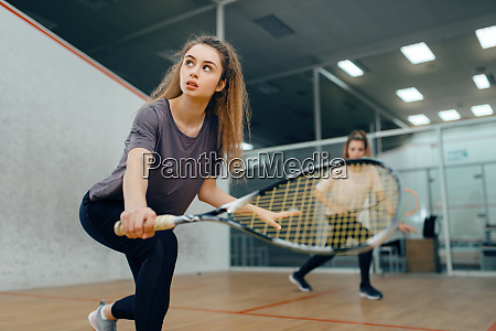 two players with squash racket playing