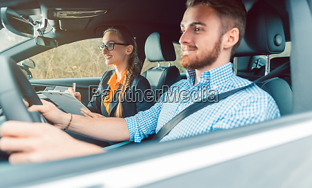 driving instructor with student in car
