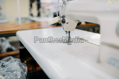 sewing machine on clothing factory nobody