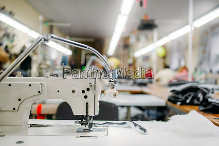 sewing machine on clothing fabric nobody