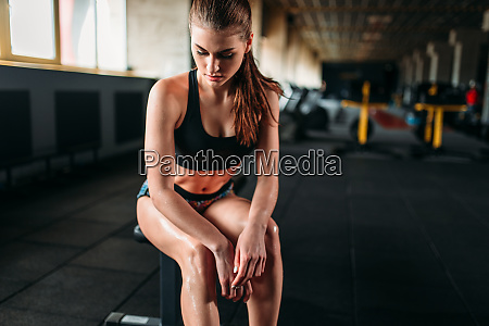 female athlete resting after training in