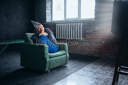 man in tinfoil helmet watch tv