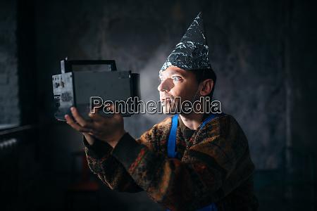 paranoid man in tinfoil cap mind