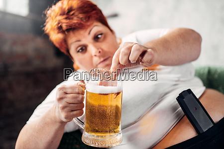 overweight woman drinks beer obesity