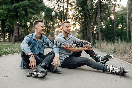 roller skating two skaters sitting on