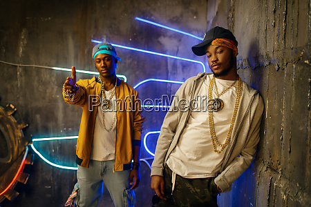 two black rappers neon lights on