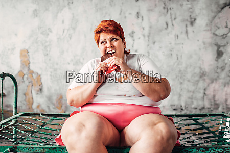 overweight woman eats chocolate obesity