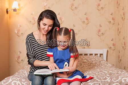 mother teach to read her little