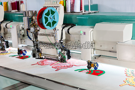 sewing machine on textile fabric nobody