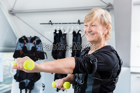 senior lady staying fit with dumbbell