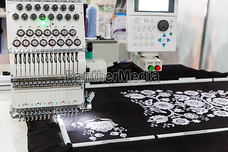 sewing machine in work textile fabric