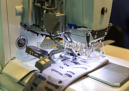 sewing machine closeup nobody clothing sew