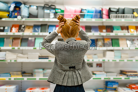 school girl in stationery store back