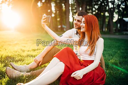 love couple makes selfie in summer