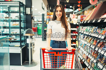 female customer with cart in food