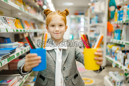 schoolgirl with colorful pencils stationery store