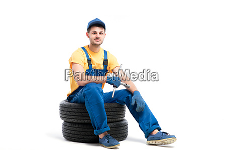 car tire service worker sitting on