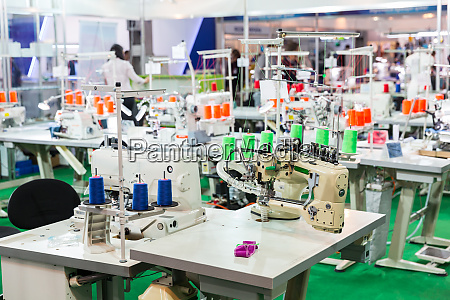 dressmaker workplace sewing machines on factory